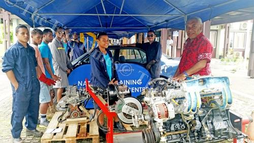 NTPC students with the Toyota engines given by ASCO Motors. Picture: NICOLLETE CHAMBERS