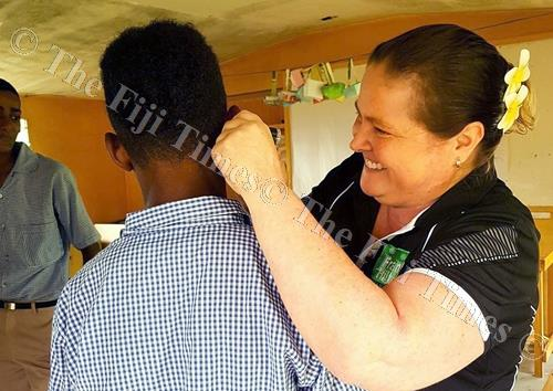 A student has his ears examined. Picture: SUPPLIED