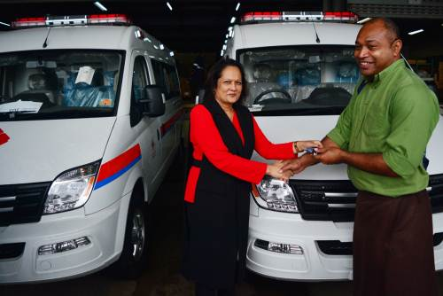 Fiji's Minister for Health Rosy Akbar hands over one of the ambulance keys to Jone Naituivau from the Labasa hospital during the official handover of the vehicles today. Picture: JOVESA NAISUA