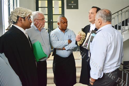 Lawyer Wylie Clarke (second from right) speaks to Fiji Times editor-in-chief Fred Wesley (centre) and Fiji Times general manager and publisher Hank Arts (second from left) outside the High Court in Suva yesterday. Picture: JOVESA NAISUA