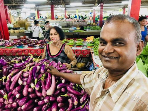 Suva Municipal market vendors Ben Madi (left) and her brother Bobby Chand with some of their produce. Picture: JOVESA NAISUA