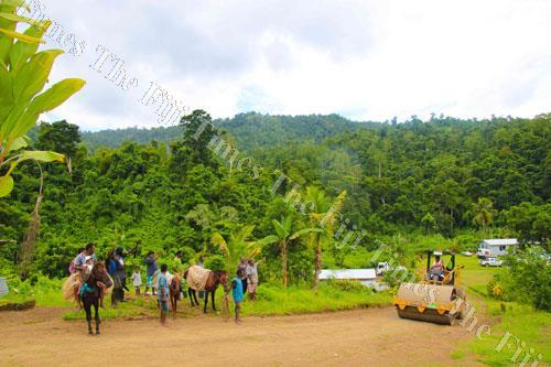 Sovusovu farmers watch as FHH opens up access to their village. Picture: SUPPLIED