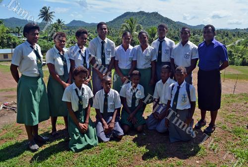 Wainibuka Secondary School athletes with coach Semisi Bainivalu at the school in Tailevu. Picture: PAULINI RATULAILAI