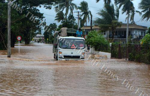 A vehicle makes its way through floodwaters in Yalalevu in Ba yesterday. Picture: LUKE NACEI