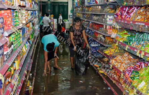 A supermarket staff member cleans up in Ba after an earlier flooding. The Consumer Council of Fiji has warned traders that increasing prices during natural disasters amounts to unfair trade practices particularly under Section 66 and 76 of Commerce Commis