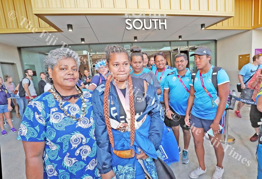 Eileen Cikamatana is led by mother Makitalena out of the Carrara Indoor Stadium. Picture: ELIKI NUKUTABU