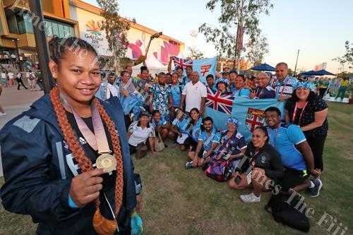 Gold medallist Eileen Cikamatana celebrates with members of Team Fiji after winning the 90kg category in weight-lifting at the Carrara Indoor Stadium. Picture: ELIKI NUKUTABU