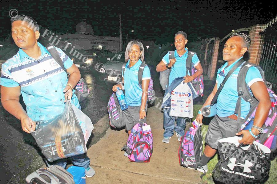 Members of the Fijiana team loading their travel gear on Thursday last week. Picture: ELIKI NUKUTABU