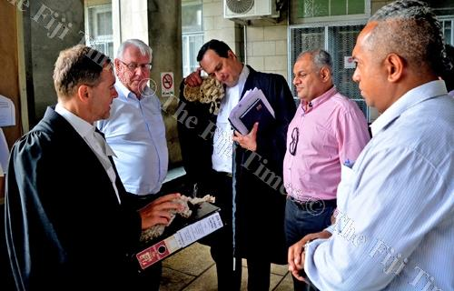 Lawyer Nicholas Barnes, Fiji Times Publisher and general manager Hank Arts, Lawyer Wylie Clarke, Motibhai Group sales and marketing executive Jinesh Patel and Fiji Times editor-in-chief Fred Wesley outside the High Court in Suva yesterday. Picture: JONA K