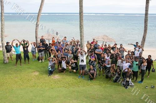 University of South Pacific Marine science students at Outrigger Fiji Beach Resort — the circle formed with their arms is Outrigger's 'O' OZONE symbol. Picture: SUPPLIED