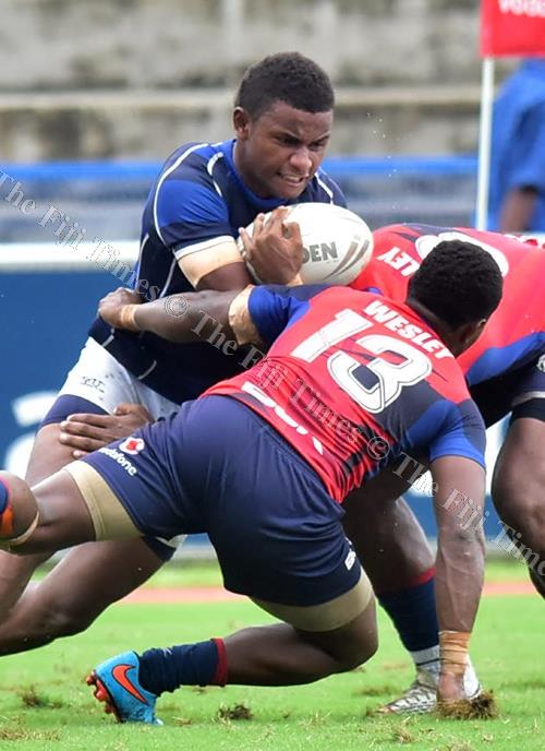 Lelean Memorial School's Pita Senawanawa powers his way through the John Wesley College defenders during their secondary schools rugby league semi-final at the ANZ Stadium last week. Picture: ATU RASEA