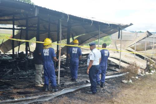 NFA and Police personnel at the scene of the fire at Naduna Technical College. Picture: LUKE RAWALAI