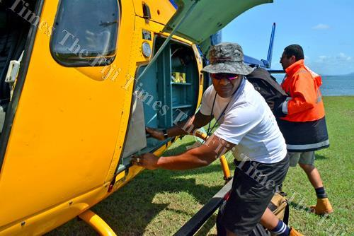 Jobe Hargrove of the Fiji Red Cross Society and Fiji Aeromedical and Rescue Service Trust rep Anthony Blake load relief supplies to be transported to Kadavu in a helicopter in Suva yesterday. Picture: JONACANI LALAKOBAU