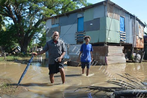 Pastor Manueli Sovau (left) with Luse Falema check on a house affected by floodwaters at Vunato settlement in Lautoka yesterday. Picture: REINAL CHAND