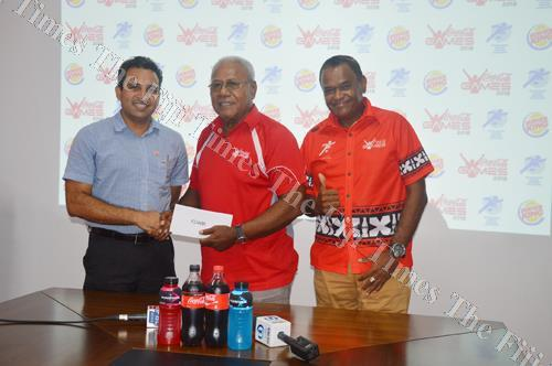 Burger King general manager Akash Narsey, left, hands over the cheque to Fiji Secondary Schools Athletics Association general secretary Vuli Waqa yesterday while Coca-Cola Amatil (Fiji) Ltd marketing manager Lawrence Tikaram looks on. Picture: MACIU MALO
