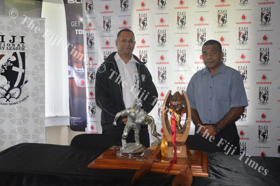FNRL chief executive officer Timoci Naleba, right, and FSSRLA administrator Laisiasa Corerega with the trophies at the FNRL office yesterday. Picture: MACIU MALO