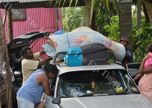 Nawachikuma residents unload their items as they return from the Andrews Primary School evacuation centre, where they were sheltered because of the recent floods, in Nadi. Picture: BALJEET SINGH