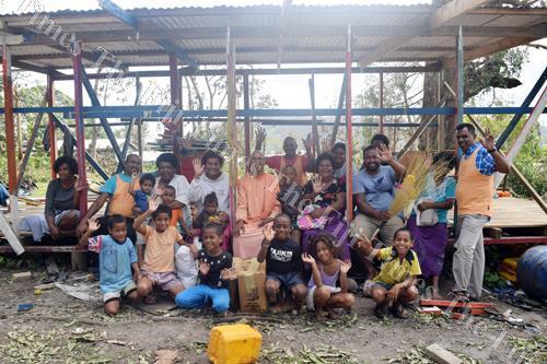 Members of the Fiji Sevashram Sangha present food supplies to Namuana villagers. Picture: Sikeli Qounadovu