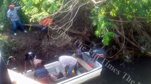 Police and fire officers rescue a woman involved in the boat accident at Qawa River yesterday. Picture: SERAFINA SILAITOGA