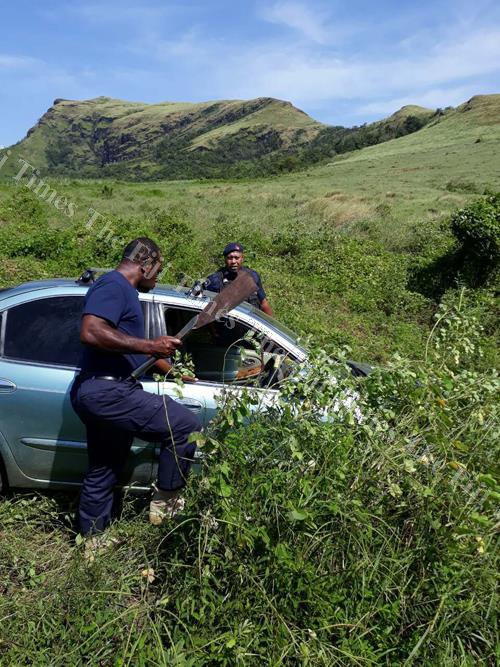 Police officers check the stolen vehicle at Naseyani Village, Ra. Picture: Supplied
