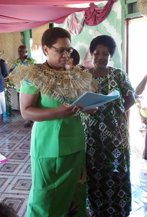 Minister for Women and Children Mereseini Vuniwaqa looks through the Senivadra Women's Club report in Votua Village, Bua. Picture: SERAFINA SILAITOGA