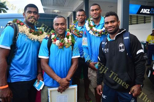 Fiji 7s players from left: Kalione Nasoko, Alasio Naduva, Sevuloni Mocenacagi, Mesulame Kunavula and captain Jerry Tuwai at the Nausori International Airport yesterday. Picture: JOVESA NAISUA