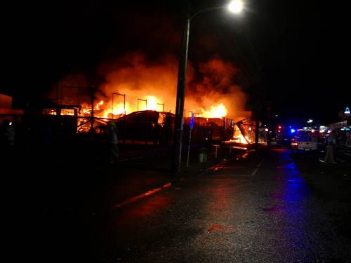 Flames engulf the building that houses Carpenters Finance and its retail outlet in main street Nausori tonight. Picture: TIMOCI VULA