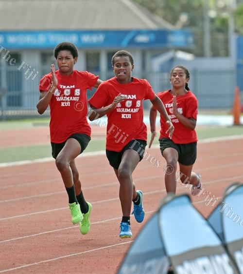 Members of Adi Cakobau School athletics team test the ANZ Stadium tracks during a training session yesterday and they prepare to defend the Coca-Cola Games girls title this weekend. Picture: RAMA