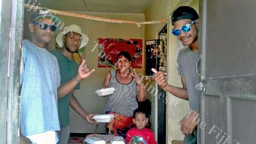 PYGMIES Youth Club members distibute food after cleaning up Lovu HART homes. Picture: SUPPLIED