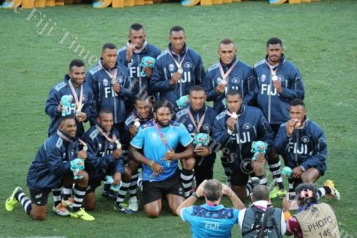 The Fiji sevens team pose for photographers after the Commonwealth Games rugby 7s medal presentations. Picture: ELIKI NUKUTABU