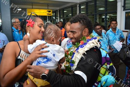 Fiji 7s team captain Jerry Tuwai is greeted by wife Ani and two children Noelani Tuwai and Mesulame Kunavula. Picture: JOVESA NAISUA