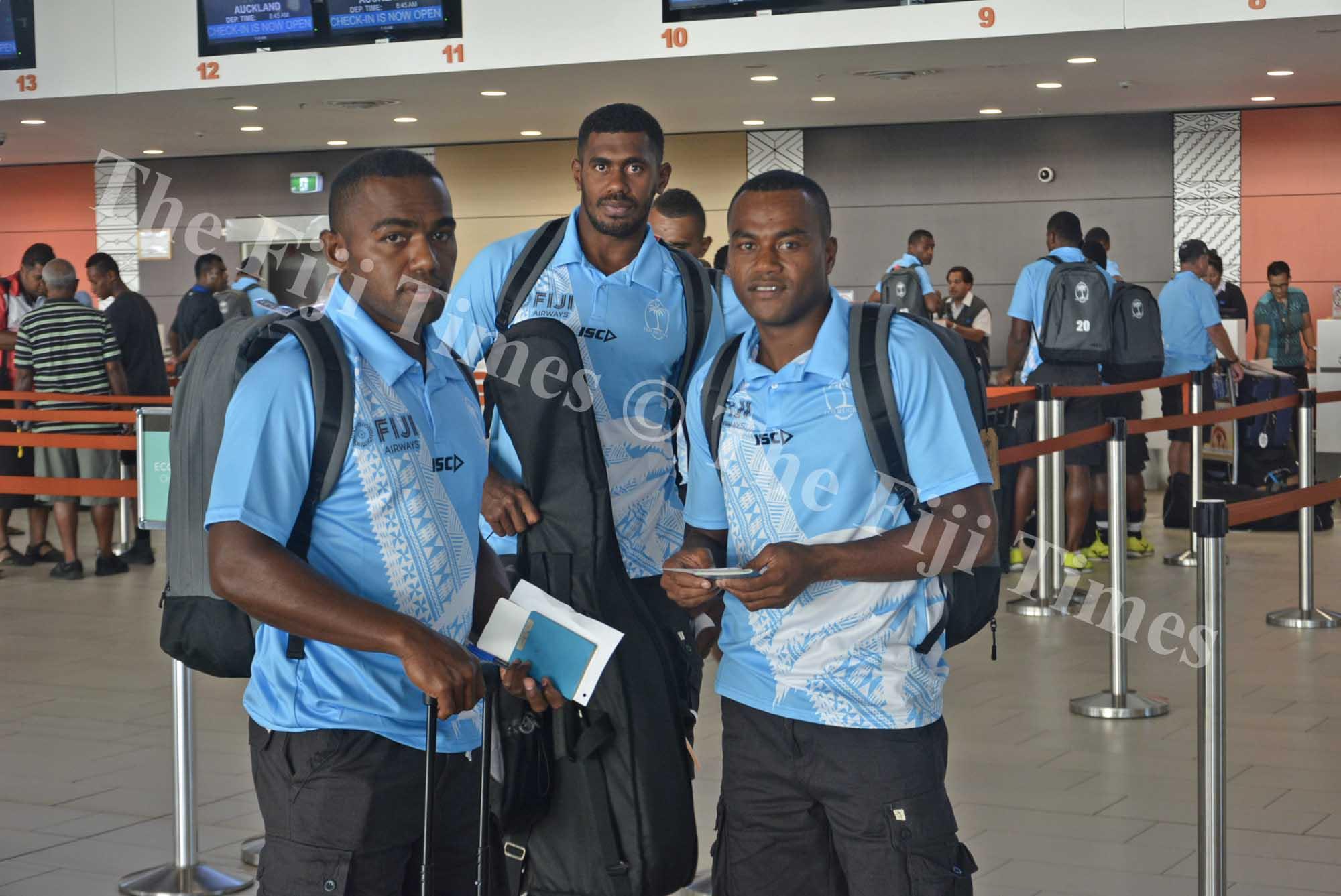 Fiji Airways Men's 7s players Waisea Nacuqu (left), Kalione Nasoko and Alosio Naduva at Nadi International Airport yesterday. Picture: REINAL CHAND
