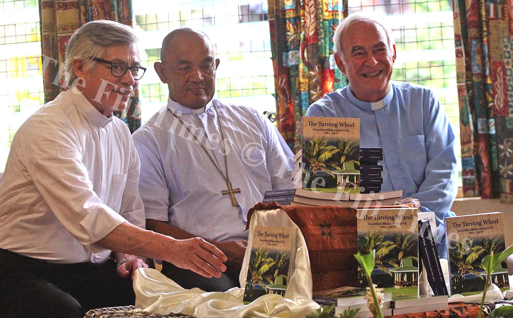 Father Arturo Aguilar,Archbishop Peter Loy Chong and Father Hoare following the book launch at the Archbishop Petero Mataca Hall yesterday. Picture: JONA KONATACI