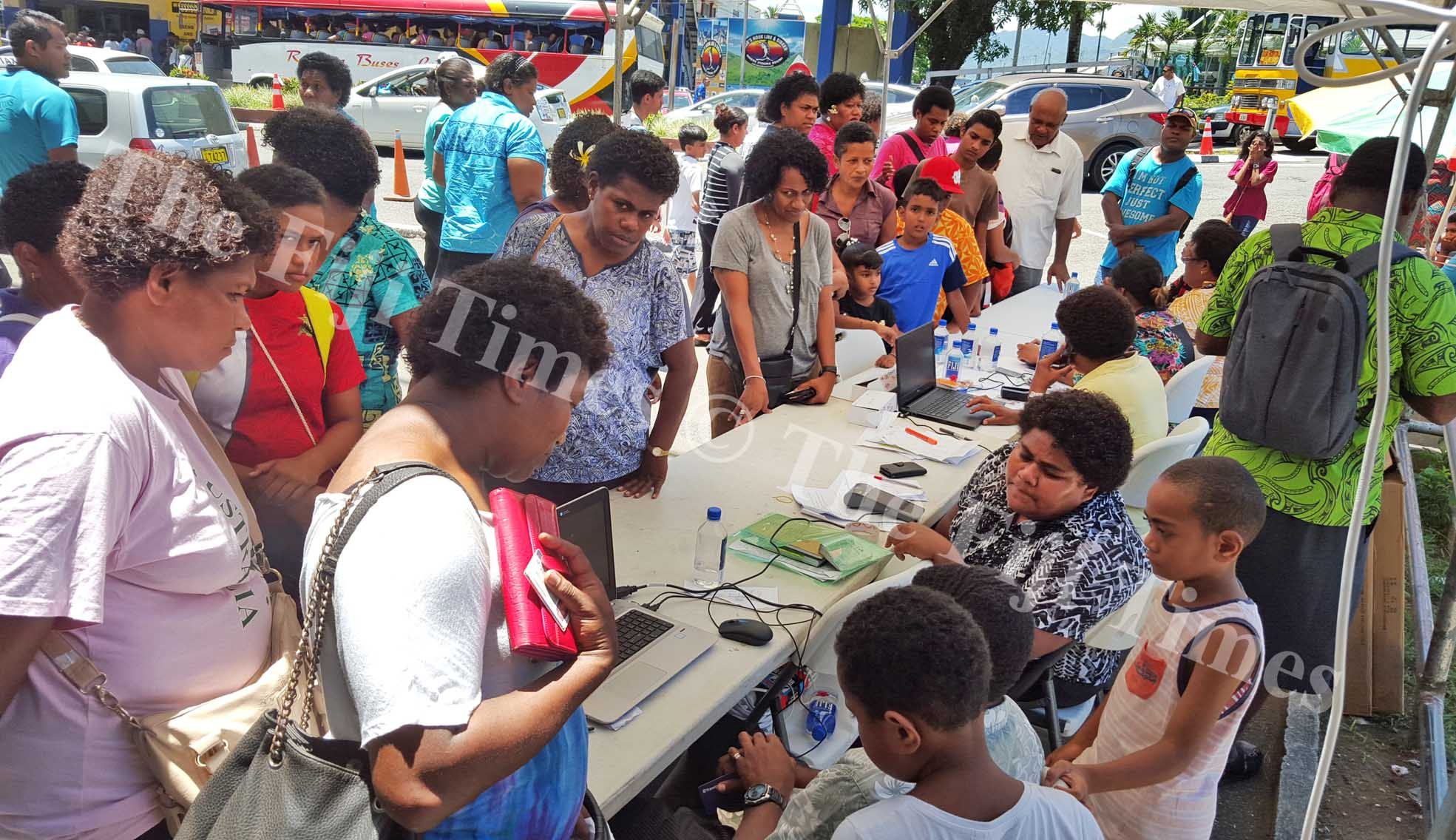 People queue up to register for students e-ticketing cards in Suva. Picture: ELIKI NUKUTABU