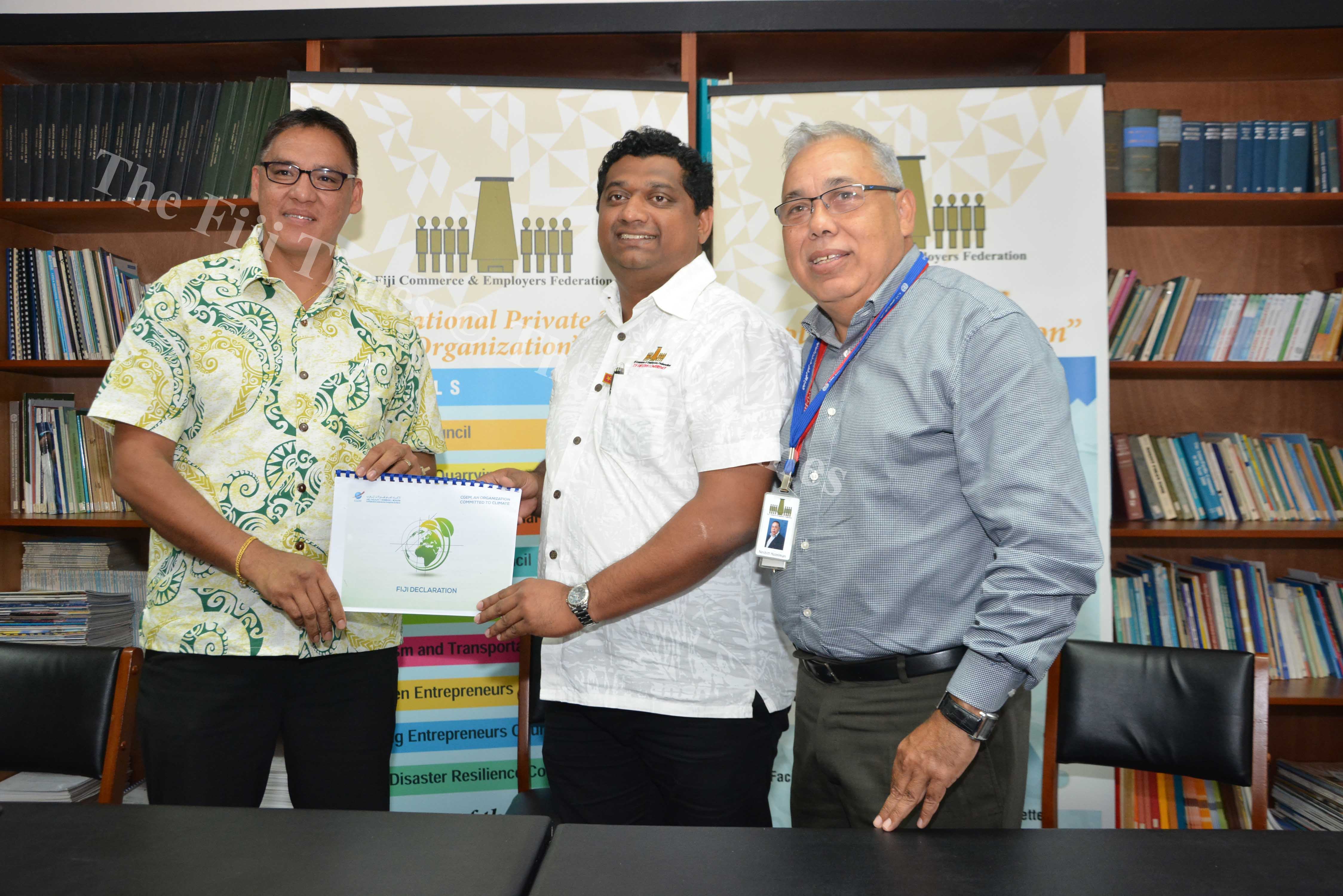 Fiji Commerce & Employers Federation CEO  Nesbitt Hazelman (right) with the Immediate Past President Himen Chandra (centre) and Fiji Business Disaster Risilience Council Vice Chair Leonard Chan during the official handover of the presidency of the MBA4 Climate (Marakech Business Action for Climate) Declaration. Picture: JOVESA NAISUA