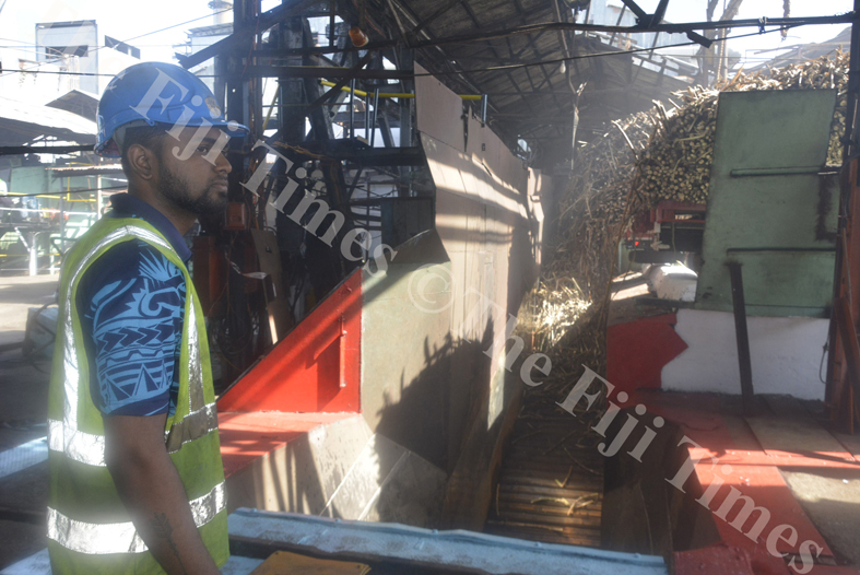 Tradesman Rovneel Chand observes the mechanicals at the sugar cane dumping site at Lautoka Mill yesterday. Picture: REINAL CHAND
