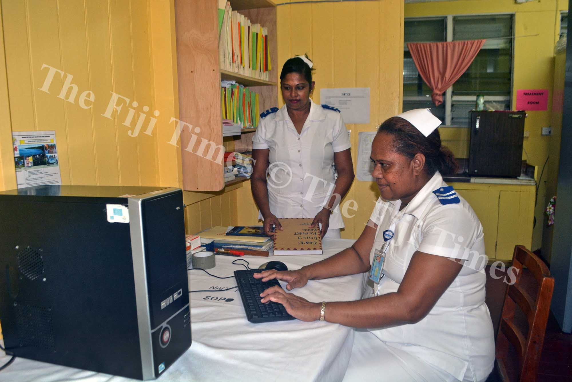 Nurses Losana Disoni (right) and Yamla Reddy work in the newly opened Special Out-Patients Department at the Nadi Hospital yesterday. Picture: REINAL CHAND