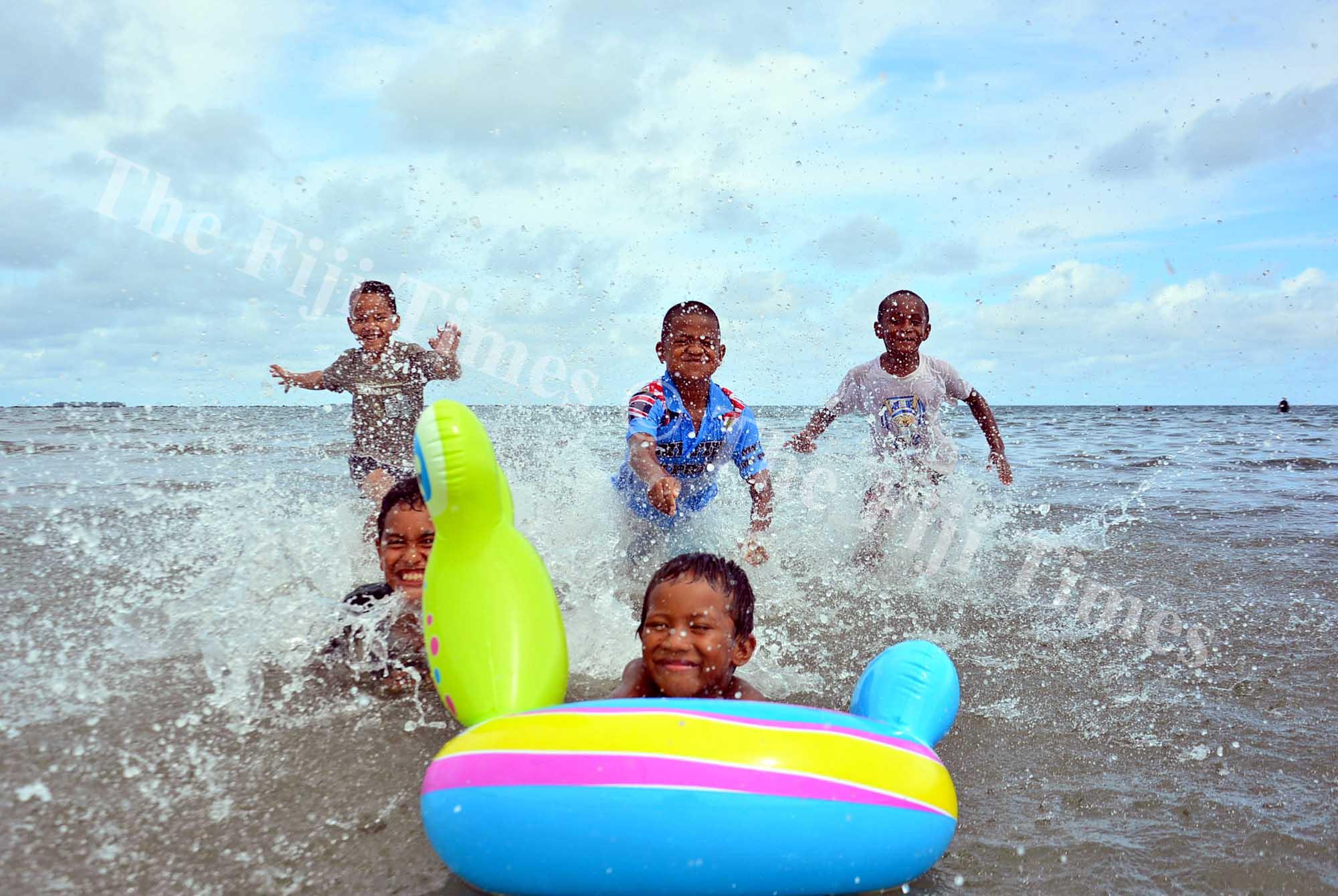 Children from left, John Turaganivalu, 6, David Apenisa, 9, Peter Ledua, 6, Mosese Rasaqa, 9, and Josaia Rakai, 6, enjoy their dayout at the beach at My Suva Picnic Park on Wednesday, January 10, 2018. Picture: JONACANI LALAKOBAU