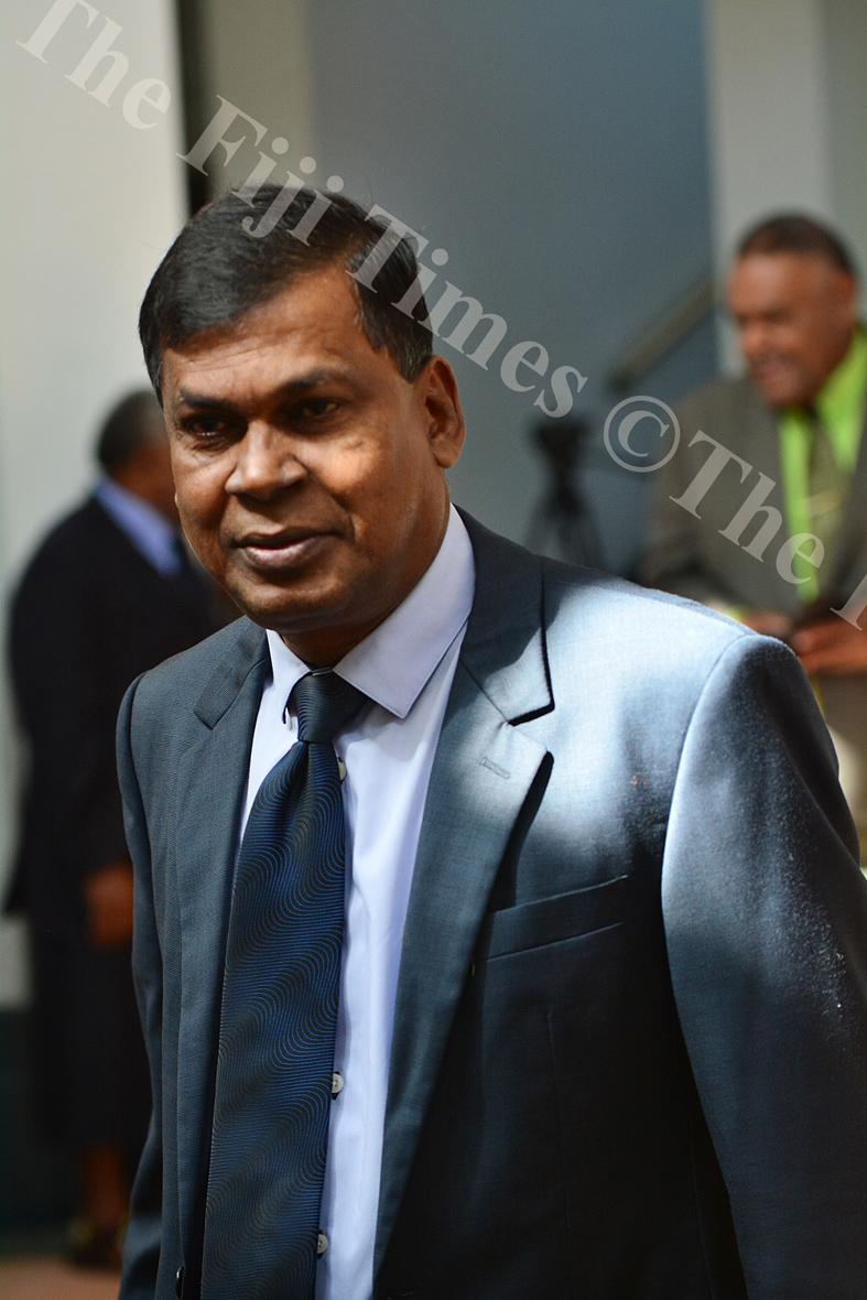 Opposition MP Biman Prasad arriving at the parliament complex in Suva. Picture: JOVESA NAISUA