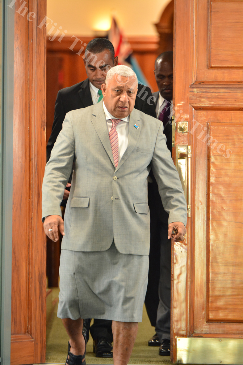 Prime Minister Voreqe Bainimarama leaving parliament with his body guards during a break in the sitting at the parliament complex in Suva yesterday. Picture: JOVESA NAISUA