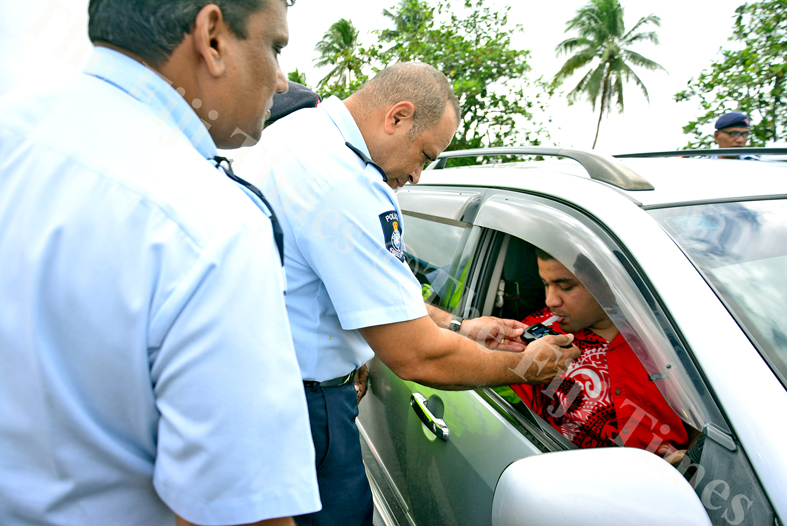 Commissioner of Police Brigadier General Sitiveni Qiliho demonstrates the use of the new breathalyser tests machines on Karan Singh after the handover of new vehicles to Police Divisional Commanders at the Police Special Response Unit (PSRU) in Nasinu on Monday, July 09, 2018. Picture: JONACANI LALAKOBAU