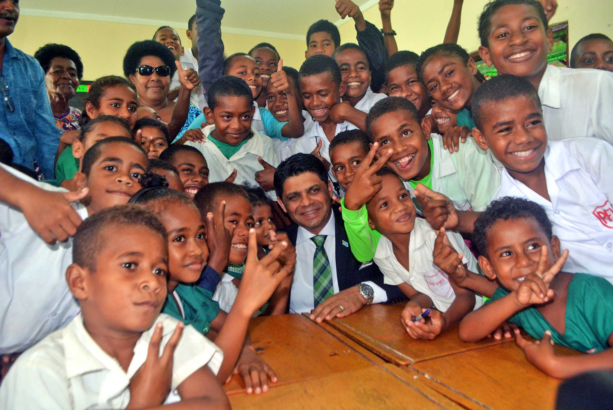 Attorney General and Minister for Education Aiyaz Sayed Khaiyum with Ratu Filimoni Vukinamualevu Memorial School students after the commissioning of the New Classrooms block in Ba yesterday. Picture: REINAL CHAND