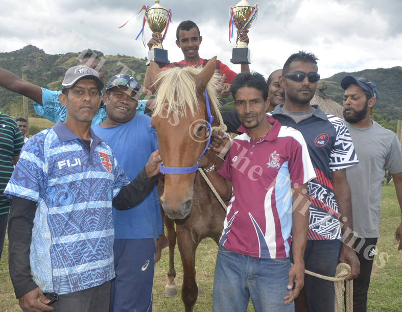 Mohammed Faruk (left) with his horse Tovolea joined family and friends pose for a photo after winning some races at the Sabeto Races in Nadi. Picture: REINAL CHAND