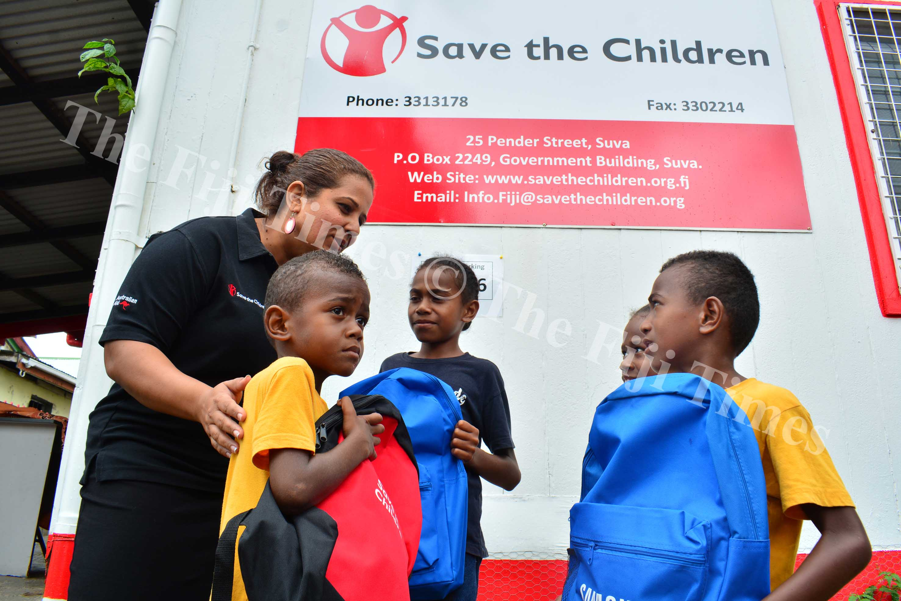 Save the Children Fiji CEO Iris Low-McKennzie speaking to the Tanoa siblings after receiving bags from the NGO in Suva yesterday. Picture: JOVESA NAISUA