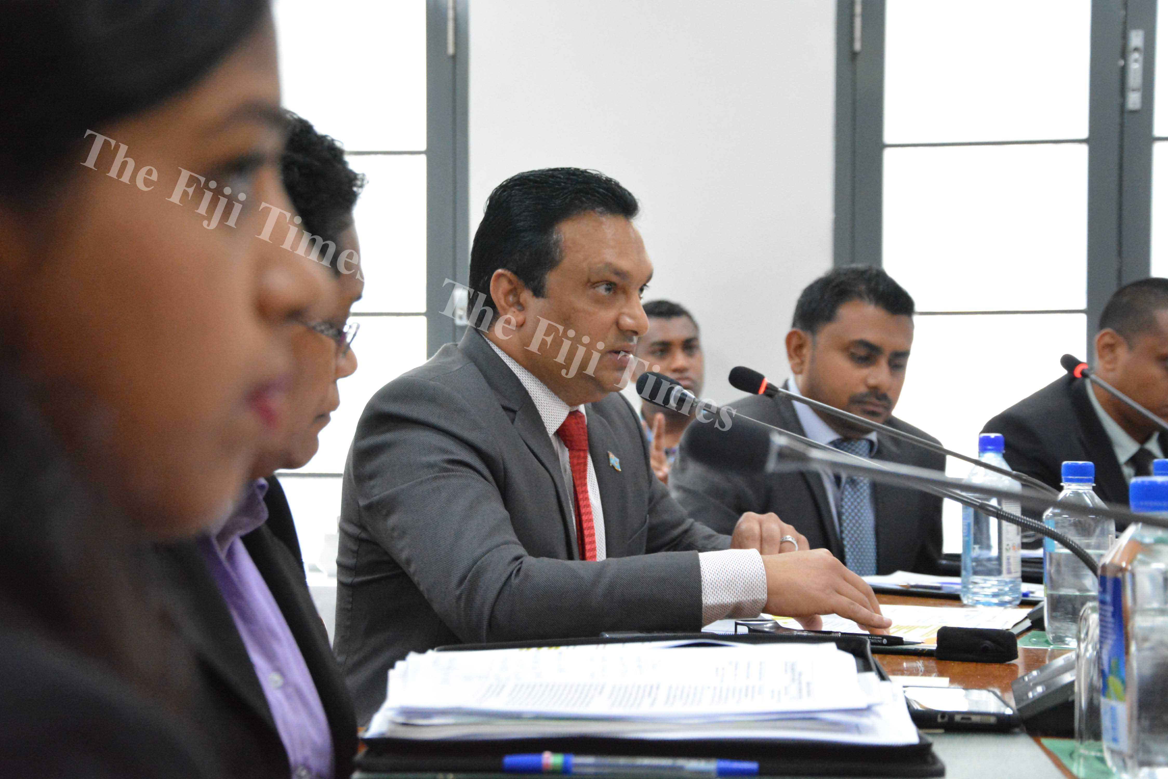 Permanent Secretary for the Ministry of Public Enterprises Jitendra Singh (centre) delivers his presentation during the Standing Committee on Public Accounts at the Parliament Complex in Suva yesterday. Picture: JOVESA NAISUA