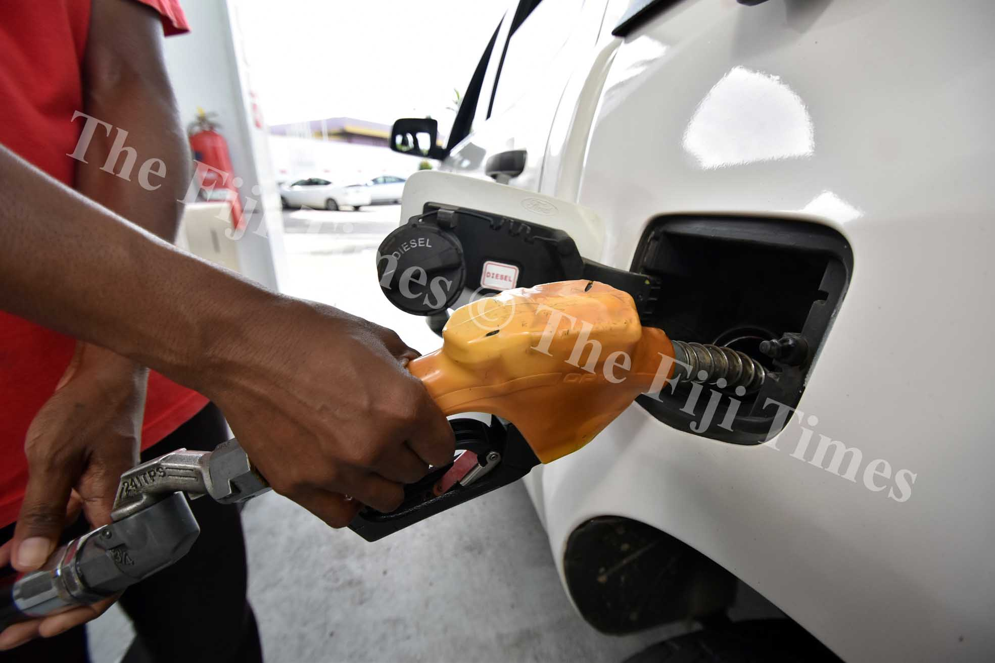 People fill up petrol yesterday as the new patrol price comes into effect from Monday. Picture: RAMA