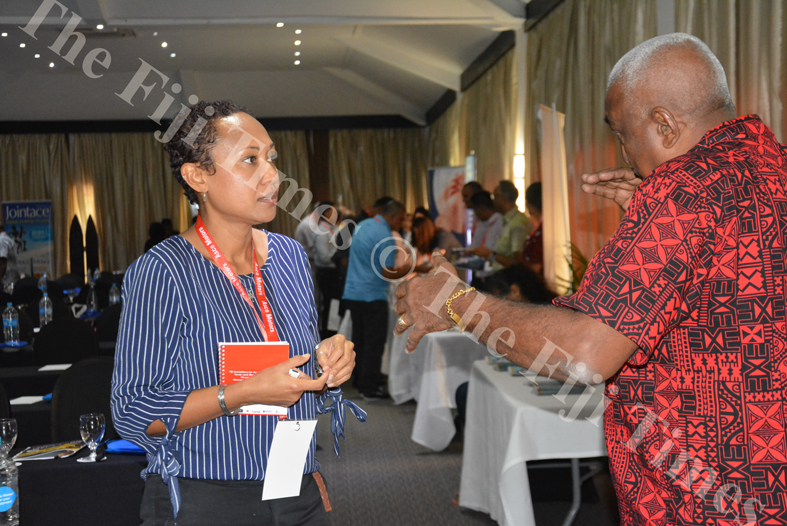 Public Health adviser of the Fiji RhD program under the Ministry of Health and Medical Service, Dr Sainimere Boladuadua sharing a word with another delegate at the Fiji College of General Practitioners conference at Warwick Fiji Resort. Picture: AQELA SUSU