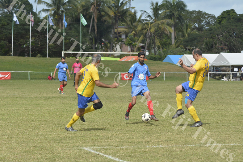 Lautoka's Prasund Lal tries to beat the Melbourne defenders during their match in the Kshatriya soccer tournament at Prince Charles Park Nadi. Picture: REINAL CHAND