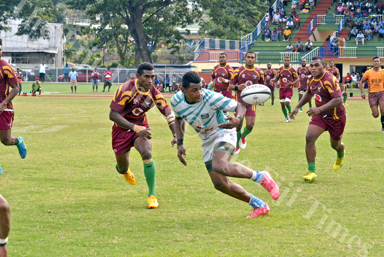 Serua outside centre Anasa Vuidravuwalu loses possession as Lautoka defenders come in during their match at Churchill Park Lautoka. Picture: REINAL CHAND