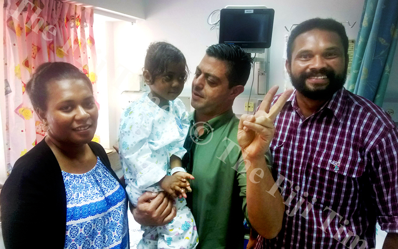 Abigail Gaunavou, 3, (second from left) with the Israel Embassy Advisor to the Pacific Yaron Dadon flanked by her parents Saimoni Gaunavou and Margaret Kane. Picture: SIKELI QOUNADOVU